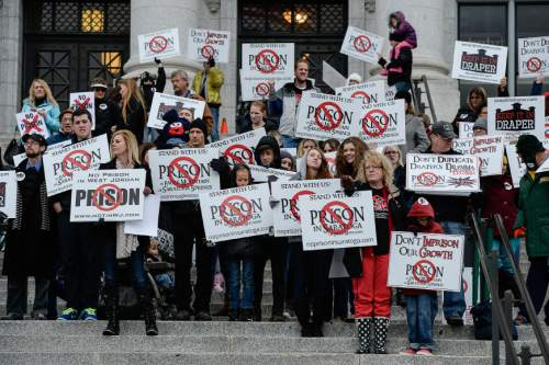 Francisco Kjolseth  |  The Salt Lake Tribune The five community groups opposing the prison relocation hold a mass protest at noon, on the south steps of the Utah Capitol on Monday, Dec. 22, 2014, two hours before the Prison Relocation Commission meeting.