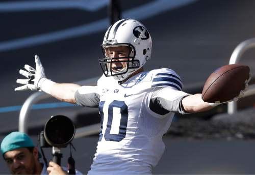Brigham Young wide receiver Mitch Mathews celebrates a touch down run during the first half of the in the inaugural Miami Beach Bowl football game against Memphis, Monday, Dec. 22, 2014 in Miami. (AP Photo/Wilfredo Lee)