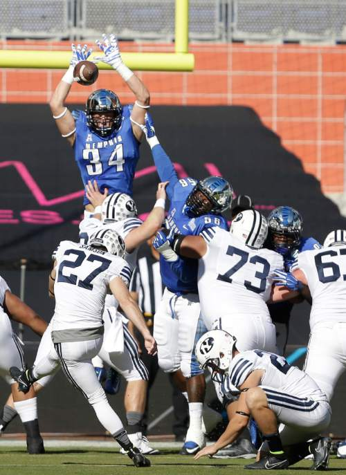 Brigham Young place kicker Trevor Samson (27) kicks an extra point after a touch down during the first half of the in the inaugural Miami Beach Bowl football game against Memphis, Monday, Dec. 22, 2014 in Miami. (AP Photo/Wilfredo Lee)