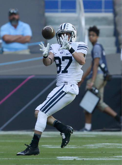 Brigham Young wide receiver Mitchell Juergens (87) catches a touchdown pass during the first half of the in the inaugural Miami Beach Bowl football game against Memphis, Monday, Dec. 22, 2014 in Miami. (AP Photo/Wilfredo Lee)