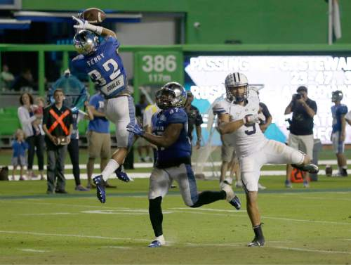 Memphis defensive back DaShaughn Terry (32) intercepts a pass intended for BYU wide receiver Jordan Leslie (9) to end the inaugural Miami Beach Bowl NCAA college football game, Monday, Dec. 22, 2014 in Miami. Memphis defeated Brigham Young 55-48 in two overtimes. (AP Photo/Wilfredo Lee)