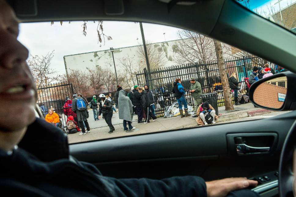 Chris Detrick  |  The Salt Lake Tribune Metro Support Deputy Chief Fred Ross drives by Catholic Community Services of Utah as homeless menand women  wait outside Tuesday, Dec. 16, 2014.