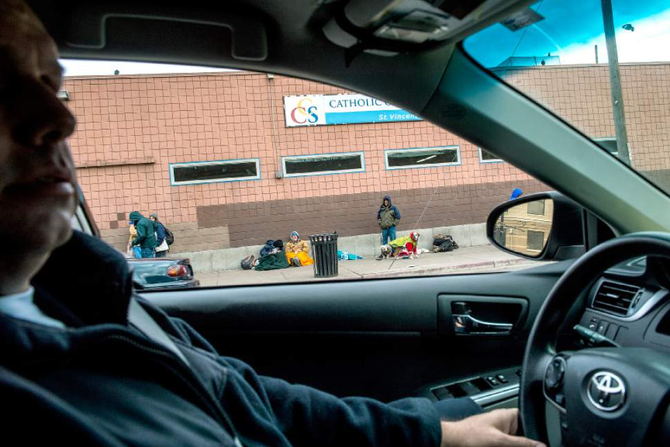 Chris Detrick  |  The Salt Lake Tribune Metro Support Deputy Chief Fred Ross drives by Catholic Community Services of Utah as homeless men wait outside Tuesday, Dec. 16, 2014.