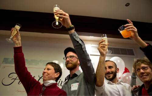 Lennie Mahler  |  The Salt Lake Tribune Kody Partridge, Derek Kitchen and Moudi Sbeity, plaintiffs in Kitchen v. Herbert, along with attorney Peggy Tomsic, hold up champagne for a toast on the anniversary of Judge Robert J. Shelby's ruling that overturned the ban on gay marriage in Utah. The celebration was held at Trolley Square in Salt Lake City, Saturday, Dec. 20, 2014.