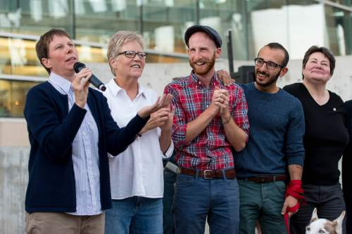 Trent Nelson  |  The Salt Lake Tribune Kitchen v. Herbert plaintiffs Kody Partridge, Laurie Wood, Derek Kitchen, Moudi Sbeity and Kate Call at a rally to celebrate today's legalization of same-sex marriage, Monday October 6, 2014 in Salt Lake City.