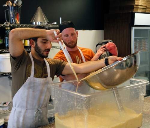 Al Hartmann  |  The Salt Lake Tribune Mohammed Sbeity and Derek Kitchen blend up a 95-carton batch of hummus in their small commericial kitchen in Salt Lake City.   They make three types of middle eastern spreads under the Laziz name.   The products will now be in 40 Utah stores, just a year after they started their business.