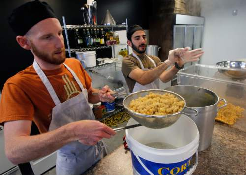 Al Hartmann  |  The Salt Lake Tribune Derek Kitchen and Mohammed Sbeity blend up a 95-carton batch of hummus in their commercial kitchen in Salt Lake City.