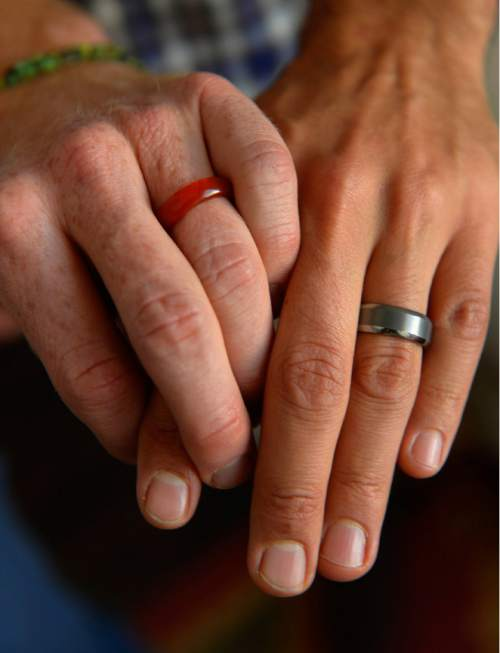 Leah Hogsten  |  The Salt Lake Tribune l-r  Derek and Moudi who met in October of 2009 are now engaged; one ring is made of carnelian, because Derek is allergic to metal and Moudi's is made of tungsten.  Plaintiffs in the now-closed case of Kitchen v. Herbert,  Derek Kitchen and  Moudi Sbeity discuss the journey to marriage equality in Utah and what it's been like to be at the focal point of one of the highest-profile, history-making gay marriage cases in the country,Thursday, October 9, 2014 at their home in Salt Lake City. The same-sex plaintiffs, whose win at the 10th Circuit Court of Appeals was upheld when the U.S. Supreme Court declined to hear the state's appeal.