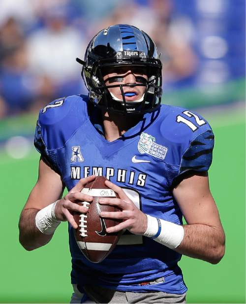 Memphis quarterback Paxton Lynch drops back to pass during the first half of the in the inaugural Miami Beach Bowl football game against Memphis, Monday, Dec. 22, 2014 in Miami. (AP Photo/Wilfredo Lee)