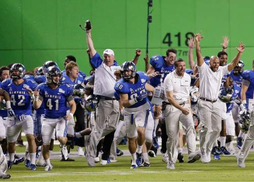 Memphis players and coaches celebrate after Memphis defeated BYU 55-48 in two overtimes in the inaugural Miami Beach Bowl NCAA college football game, Monday, Dec. 22, 2014, in Miami. (AP Photo/Wilfredo Lee)