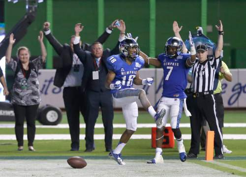 Memphis wide receiver Roderick Proctor (18) celebrates after making a touch down during double overtime in the inaugural Miami Beach Bowl football game against Brigham Young, Monday, Dec. 22, 2014 in Miami. Memphis defeated Brigham Young 55-48. (AP Photo/Wilfredo Lee)