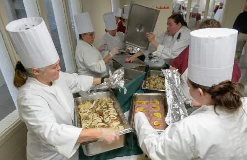 Francisco Kjolseth  |  The Salt Lake Tribune A large meal, prepared by femail inmates, comes together on Friday, Dec 5, 2014.