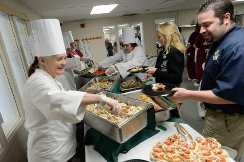 Francisco Kjolseth  |  The Salt Lake Tribune Diana Carlson serves herb roasted turkey during a holiday luncheon on Friday, Dec 5, 2014.