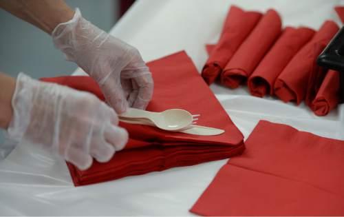 Francisco Kjolseth  |  The Salt Lake Tribune Female inmates work on ever detail of their event, including rollingthe  utensils in napkins. Friday, Dec 5, 2014.