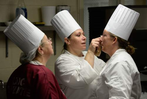Francisco Kjolseth  |  The Salt Lake Tribune Shoni Kelsey, center, wipes away Jamie Greenwood streaked makeup. Greenwood got emotional when her chocolate peppermint cheesecake turned out. At left Sherrie Beckering adds moral support.