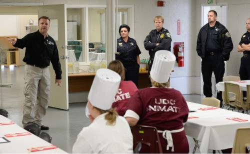 Francisco Kjolseth  |  The Salt Lake Tribune Captain Jeff Wilson, head of education and vocational life skills at the Utah State Prison, offers words of encouragement to the culinary students.