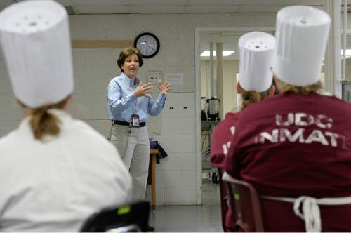 Francisco Kjolseth  |  The Salt Lake Tribune Mary Crawford, DATC program director, offers words of encouragement to the culinary students.