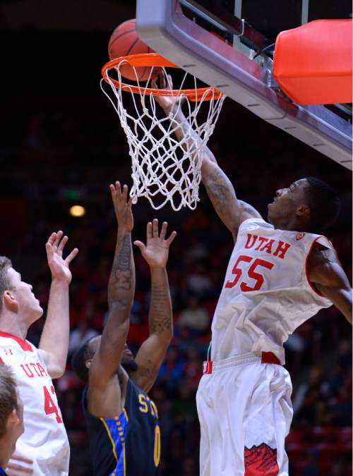 Leah Hogsten  |  The Salt Lake Tribune Utah Utes guard Delon Wright (55) from behind the net. The University of Utah men's basketball team defeated the South Dakota State Jackrabbits, 80-66, Tuesday, December 23, 2014 at the Jon M. Huntsman Center.