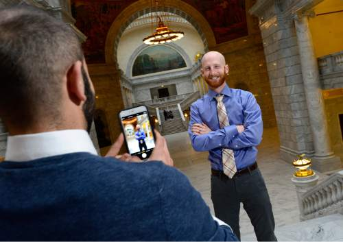 Scott Sommerdorf   |  The Salt Lake Tribune Moudi Sbeity, left, takes a photo of his husband, Derek Kitchen, at the Utah State Capitol, Sunday, Dec. 21, 2014.
