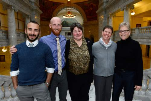 Scott Sommerdorf   |  The Salt Lake Tribune From left to right; Moudi Sbeity and Derek Kitchen, Kate Call, and Laurie Wood and Kody Partridge. Kate Call's wife, Karen Archer, was unable to attend due to illness. At the Utah State Capitol, Sunday, Dec. 21, 2014.