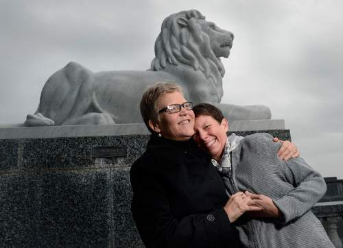 "Scott Sommerdorf   |  The Salt Lake Tribune Kody Partridge and Laurie Wood near the Lion sculpture named ""Patience"" outside the Utah State Capitol, Sunday, Dec. 21, 2014."