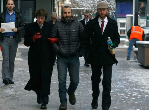 Scott Sommerdorf   |  The Salt Lake Tribune Moudi Sbeity, center, and Derek Kitchen, right, arrive with their attorney Peggy A. Tomsic at U.S. District Court Wednesday morning, Dec. 4, 2013, to appear before Judge Robert J. Shelby who will hear arguments in the lawsuit brought by three couples who argue Utah's ban on same-sex marriage is unconstitutional. The woman at left is unidentified.