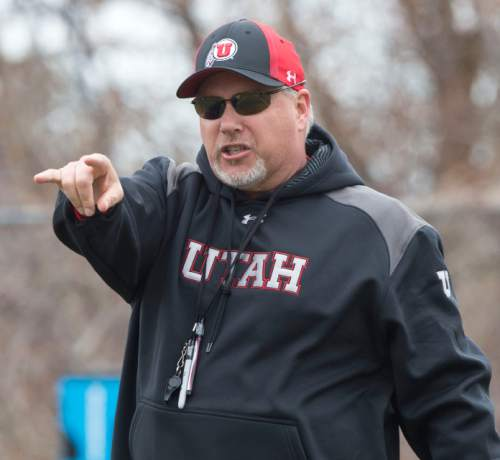 Steve Griffin  |  The Salt Lake Tribune   New University of Utah offensive coordinator, Dave Christensen, works with players during spring football practice on the University of Utah campus in Salt Lake City, Utah Tuesday, March 18, 2014.