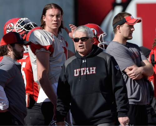 Scott Sommerdorf   |  The Salt Lake Tribune Utah QB Travis Wilson and new offensive coordinator Dave Christensen during Utah football practice at Rice Eccles Stadium, Saturday, March 22, 2014.