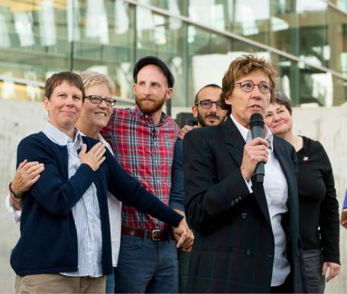 Trent Nelson  |  The Salt Lake Tribune Attorney Peggy Tomsic speaks in front of plaintiffs Kody Partridge, Laurie Wood, Derek Kitchen, Moudi Sbeity and Kate Call at a rally to celebrate today's legalization of same-sex marriage, Monday October 6, 2014 in Salt Lake City.