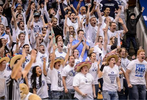 Trent Nelson  |  The Salt Lake Tribune BYU fans celebrate a three-pointer by Brigham Young Cougars guard Kyle Collinsworth (5) to tie the game at the half, 43-43, as BYU hosts Gonzaga, men's college basketball at the Marriott Center in Provo, Saturday December 27, 2014.
