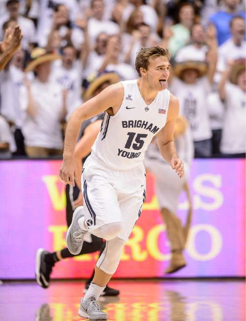 Trent Nelson  |  The Salt Lake Tribune Brigham Young Cougars guard Jake Toolson (15) wags his tongue after hitting a three-pointer in the first half as BYU hosts Gonzaga, men's college basketball at the Marriott Center in Provo, Saturday December 27, 2014.