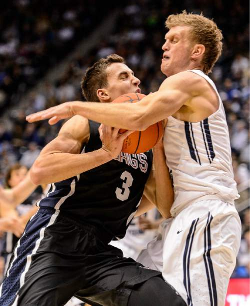 Trent Nelson  |  The Salt Lake Tribune Gonzaga Bulldogs guard Kyle Dranginis (3) runs into Brigham Young Cougars guard Tyler Haws (3) as BYU hosts Gonzaga, men's college basketball at the Marriott Center in Provo, Saturday December 27, 2014.