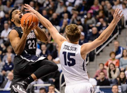 Trent Nelson  |  The Salt Lake Tribune Gonzaga Bulldogs guard Byron Wesley (22) shoots over Brigham Young Cougars guard Jake Toolson (15) as BYU hosts Gonzaga, men's college basketball at the Marriott Center in Provo, Saturday December 27, 2014.