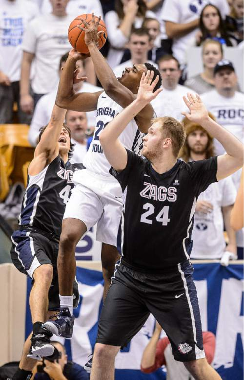 Trent Nelson  |  The Salt Lake Tribune Brigham Young Cougars guard Anson Winder (20) puts up a shot, defended by Gonzaga Bulldogs guard Kevin Pangos (4) and center Przemek Karnowski (24) as BYU hosts Gonzaga, men's college basketball at the Marriott Center in Provo, Saturday December 27, 2014.