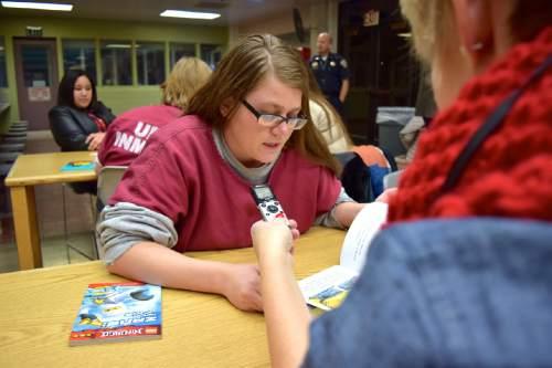 Courtesy of Brooke Adams, Utah Department of Corrections Inmate Maria King reads with volunteer Kristin Kmetzsch as part of the Utah State Prison's Bedtime Stories Program.