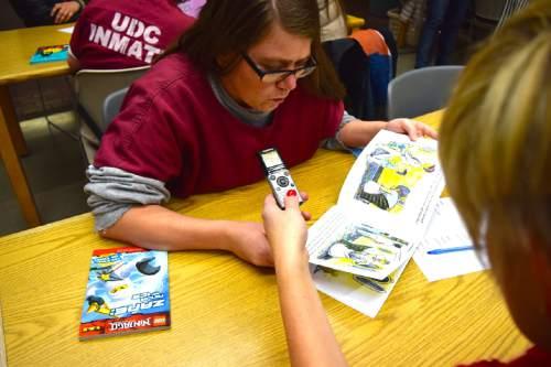 (Brooke Adams, Utah Department of Corrections) Inmate Maria King reads with volunteer Kristin Kmetzsch as part of the Utah State Prison's Bedtime Stories Program.