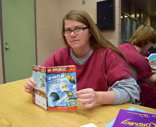 (Brooke Adams, Utah Department of Corrections) Inmate Maria King participates in the Utah State Prison's Bedtime Stories Program.