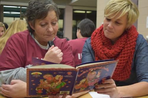 (Brooke Adams, Utah Department of Corrections)  Inmate Debbie Samples reads with volunteer Kristin Kmetzsch as part of the Utah State Prison's Bedtime Stories Program.