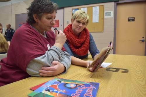 (Brooke Adams, Utah Department of Corrections)  Inmate Debbie Samples reads with volunteer Kristin Kmetzsch as part of the Utah State Prison's Bedtime Stories Program