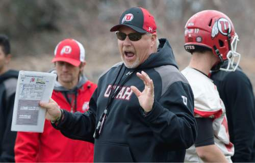 Steve Griffin     The Salt Lake Tribune   New University of Utah offensive coordinator, Dave Christensen, works with players during spring football practice on the University of Utah campus in Salt Lake City, Utah Tuesday, March 18, 2014.