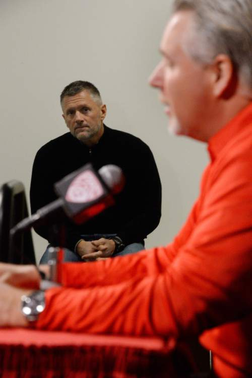 Francisco Kjolseth     The Salt Lake Tribune Dave Christensen, Utah's newest offensive coordinator is introduced during a press conference at the University of Utah football practice facility on Tuesday, Jan. 7. 2014, as coach Kyle Whittingham listens in.