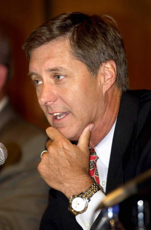 Dr. Chris Hill, University of Utah Athletic Director, talks about NCAA violations and sanctions at a press conference at the University. photo: fraughton 7/30/03