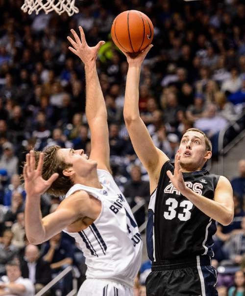 Trent Nelson  |  The Salt Lake Tribune Gonzaga Bulldogs forward Kyle Wiltjer (33) shoots over Brigham Young Cougars forward Luke Worthington (41) as BYU hosts Gonzaga, men's college basketball at the Marriott Center in Provo, Saturday December 27, 2014.