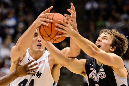 Trent Nelson  |  The Salt Lake Tribune Brigham Young Cougars center Corbin Kaufusi (44) and Gonzaga Bulldogs guard Kevin Pangos (4) scramble for the ball as BYU hosts Gonzaga, men's college basketball at the Marriott Center in Provo, Saturday December 27, 2014.