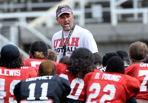 Al Hartmann  |  The Salt Lake Tribune  Ute head football coach Kyle Whittingham runs practice at Ute football camp Wednesday August 13.