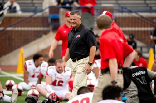 Jeremy Harmon  |  The Salt Lake Tribune  Kyle Whittingham inspects his team before taking on Michigan in Ann Arbor, Saturday, Sept. 20, 2014.