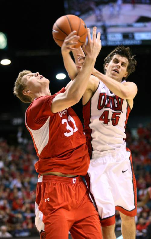 Utah's Dallin Bachynski, left, and UNLV's Cody Doolin struggle over for the ball during the first half of an NCAA college basketball game Saturday, Dec. 20, 2014, in Las Vegas.  (AP Photo/Ronda Churchill)