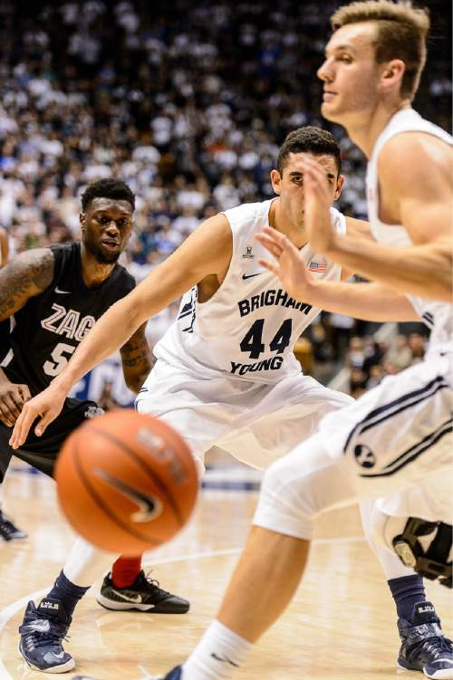 Trent Nelson  |  The Salt Lake Tribune Gonzaga Bulldogs guard Gary Bell Jr. (5), Brigham Young Cougars center Corbin Kaufusi (44) and Brigham Young Cougars guard Kyle Collinsworth (5) watch the ball go out of bounds as BYU hosts Gonzaga, men's college basketball at the Marriott Center in Provo, Saturday December 27, 2014.