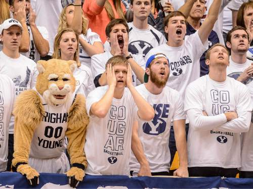Trent Nelson  |  The Salt Lake Tribune BYU fans react to the loss, as BYU hosts Gonzaga, men's college basketball at the Marriott Center in Provo, Saturday December 27, 2014.