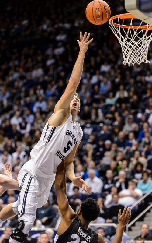 Trent Nelson  |  The Salt Lake Tribune Brigham Young Cougars guard Kyle Collinsworth (5) puts a shot up over Gonzaga Bulldogs guard Byron Wesley (22) as BYU hosts Gonzaga, men's college basketball at the Marriott Center in Provo, Saturday December 27, 2014.